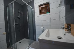Łazienka w obiekcie Domki Falsztyn