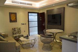Uma área de estar em Nersyan Taiba Hotel Apartments