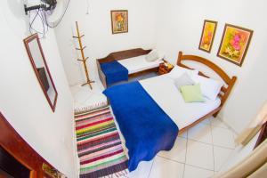 Cama ou camas em um quarto em Pousada Mãe Natureza Ilha Grande