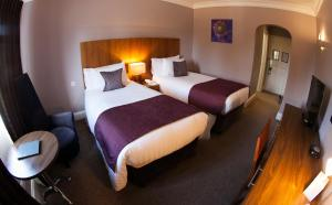 A bed or beds in a room at Best Western Plus Centurion Hotel