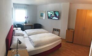 Ein Bett oder Betten in einem Zimmer der Unterkunft Weinhaus Selmigkeit
