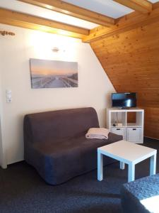 Ein Sitzbereich in der Unterkunft Landhaus Levitzow