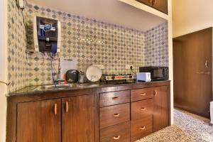 A kitchen or kitchenette at Aspire Apartments