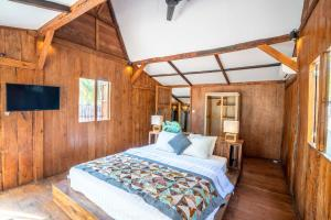 A bed or beds in a room at Coconut Garden Resort