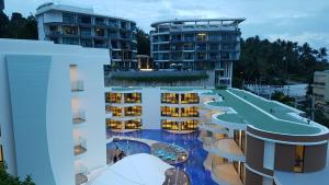A view of the pool at Lets Phuket Twin Sands Resort & Spa or nearby