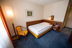 Ein Bett oder Betten in einem Zimmer der Unterkunft Ochsen Lenzburg