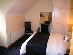 Un ou plusieurs lits dans un hébergement de l'établissement Mountain View Guesthouse