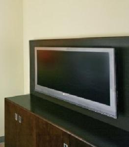 A television and/or entertainment center at Atheneum Suite Hotel