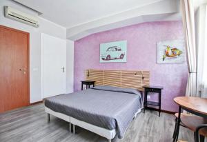 Ένα ή περισσότερα κρεβάτια σε δωμάτιο στο Vacanze a Roma
