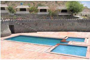 The swimming pool at or close to Devi Palace Resort