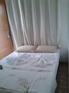 A bed or beds in a room at POUSADA OLÍMPIA