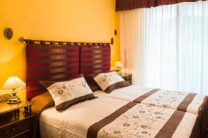 A bed or beds in a room at Pension ARCA