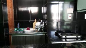 Una cocina o zona de cocina en Apartamento Edificio Ajuricaba
