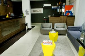 The lobby or reception area at Stop Inn Plus Pampulha