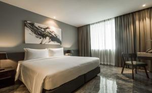A bed or beds in a room at Zazz Urban Bangkok