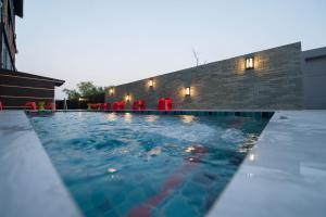 The swimming pool at or close to Dwella Suvarnabhumi