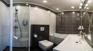 A bathroom at Amrita Hotel