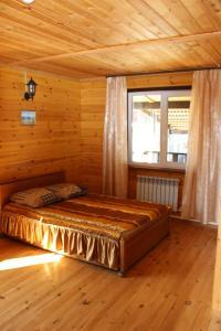 """Кровать или кровати в номере Гостевой дом """"Молодежный"""""""