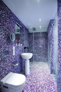 A bathroom at abito Suites