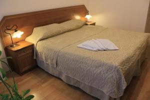 Кровать или кровати в номере Nouvelle Europe гостевые комнаты