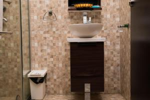 A bathroom at Whitefield Hotels Limited