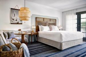 A bed or beds in a room at The Scott Resort & Spa