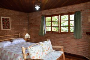 Cama ou camas em um quarto em Pousada Das Araucárias