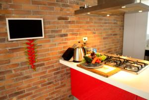 A kitchen or kitchenette at Magdalena Guest House