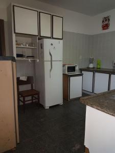 A kitchen or kitchenette at Casa Toque Toque Pequeno
