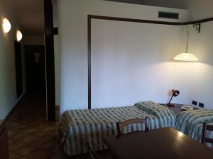 Кровать или кровати в номере Balletti Park Hotel
