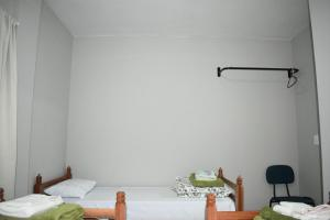 A bed or beds in a room at Pousada Ecoville