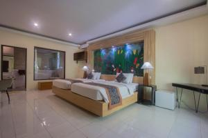 A bed or beds in a room at Dewangga Ubud