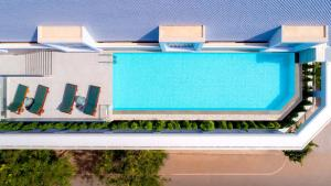 A view of the pool at ibis Styles Siem Reap or nearby