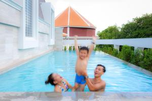 The swimming pool at or near ibis Styles Siem Reap