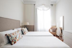 Cama o camas de una habitación en Barcelona Apartment Val