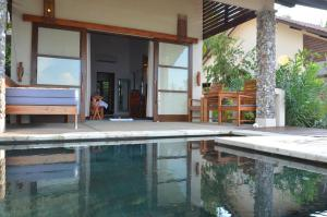 The swimming pool at or near Cocotinos Sekotong Lombok
