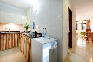 A kitchen or kitchenette at Hotel Faycán