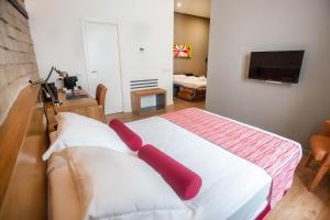 Cama o camas de una habitación en Soho Boutique Capuchinos & Spa