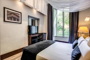 Ένα ή περισσότερα κρεβάτια σε δωμάτιο στο Hotel Giuggioli