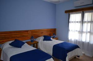 Cama o camas de una habitación en Hotel Museo y Restaurant Fordt City