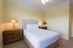 A bed or beds in a room at Tuscana Resort Orlando by Aston