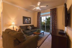 A seating area at Tuscana Resort Orlando by Aston