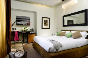 A bed or beds in a room at Babuino 181 - Small Luxury Hotels of the World