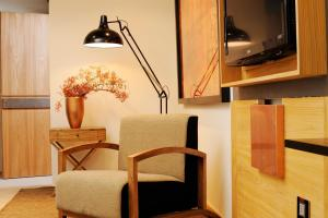 A television and/or entertainment center at Babuino 181 - Small Luxury Hotels of the World