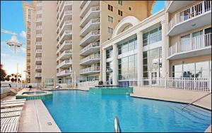 The swimming pool at or near Majestic Sun 1014B- Shades of Blue by RealJoy Vacations