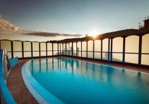 The swimming pool at or near Grand Hotel Excelsior