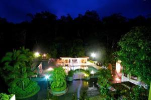 Вид на бассейн в El Tucano Resort & Thermal Spa или окрестностях