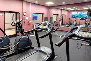 The fitness center and/or fitness facilities at Best Western Plus University Inn & Conference Center
