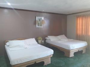 En eller flere senge i et værelse på Panglao Grande Resort 邦劳美丽度假村
