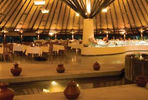 A restaurant or other place to eat at Coco Palm Dhuni Kolhu